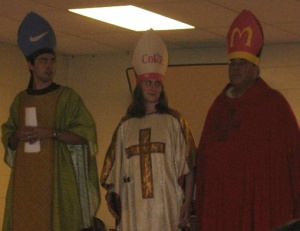 A skit at Peterin, the real camp behind Camp Madison. (We fake bishops had corporate sponsorships for our miters.) With the Rev. Siobhan Patterson and the late Rev. Keith Butler.